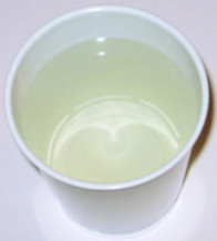 Cup of yellow colloidal silver