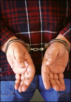Handcuffed man