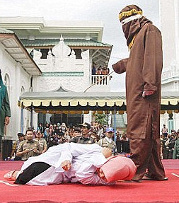 Muslim woman being beaten
